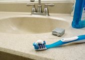 image of sink  - Tooth brush dental floss and mouthwash on the bathroom sink - JPG