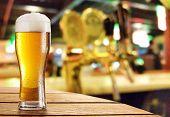 pic of beer mug  - Glass of light beer on a dark pub - JPG