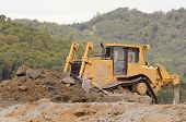 image of bulldozer  - Large bulldozer leveling out fill at a airport runway extension project in Oreegon - JPG