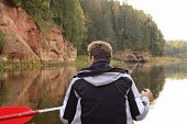 picture of canoe boat man  - A man in a boat enjoying nature