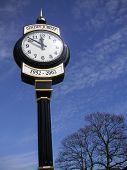 Clock Against Blue Sky poster