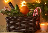 stock photo of avocado tree  - Christmas basket and candle closeup - JPG