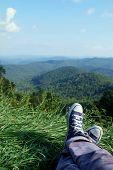 picture of blue ridge mountains  - Legs and feet crossed in the bottom of the frame - JPG