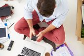 stock photo of telecommuting  - Overhead View Of Start Up Business Moving Into Office - JPG