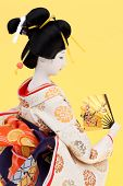 picture of geisha  - Side view of traditional Japanese geisha doll - JPG