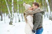 foto of amor  - Young amorous couple standing face to face and looking at one another - JPG