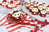 stock photo of yule  - Christmas holiday Strawberry Santas with cherry red velvet cupcakes dessert party food in modern red and white theme  - JPG