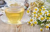 foto of calm  - Cup of herbal chamomile tea on a wooden table - JPG