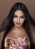 Постер, плакат: cute happy young indian woman in studio close up smiling fashion mulatto