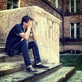foto of sad  - Toned Photo of Sad Teenager on the Landing Steps of the Old House - JPG