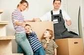 stock photo of movers  - Family moving in their new house - JPG