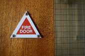 image of door  - red triangle fire door sign fitted to door - JPG