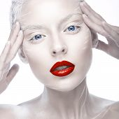 stock photo of albinos  - Beautiful girl in the image of albino with red lips and white eyes - JPG