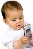 pic of mobile-phone  - baby girl with a mobile phone over white - JPG