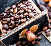 picture of wooden box from coffee mill  - Old wooden box with coffee beans inside - JPG