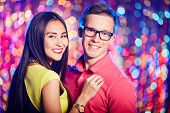 foto of amor  - Amorous young couple looking at camera while enjoying party - JPG