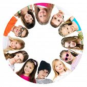 foto of huddle  - Group of smiling kids standing in huddle on white background - JPG