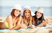 stock photo of sunbather  - summer holidays and vacation  - JPG