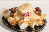 stock photo of eclairs  - Eclair tasty dessert with cream and powdered sugar - JPG