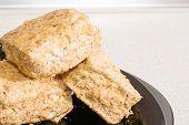 foto of eclairs  - Eclair tasty dessert with cream and powdered sugar - JPG
