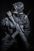 picture of anti-terrorism  - Russian special forces operator in black uniform and gas mask - JPG