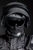 stock photo of special forces  - Russian special forces operator in black uniform and bulletproof helmet - JPG