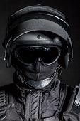 stock photo of anti-terrorism  - Russian special forces operator in black uniform and bulletproof helmet - JPG
