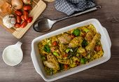 image of curry chicken  - Roasted chicken quarters with curry vegetables cauliflower tomatoes and leek - JPG