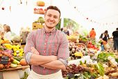picture of farmers market vegetables  - Male Stall Holder At Farmers Fresh Food Market - JPG