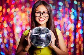 image of posh  - Posh girl in eyeglasses holding disco ball - JPG