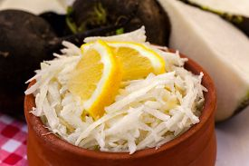 picture of grated radish  - Grated black radish salad with lemon slices - JPG