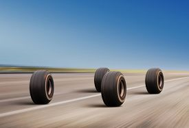 picture of four-wheel  - four automobile wheels rush on the road with high speed - JPG