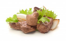 picture of liver fry  - Fried pieces of beef liver with fresh green lettuce basil and fried onion on the white - JPG