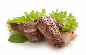 pic of liver fry  - Fried pieces of beef liver with fresh green lettuce basil and fried onion on the white - JPG