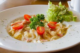 stock photo of carbonara  - Pasta Carbonara with cherry tomatoes bacon and cheese - JPG
