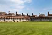stock photo of carthusian  - Carterhouse of Pavia cell complex over a grass field - JPG