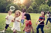 Group of Diverse Kids Playing at the Field Together poster