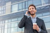 Man talking on smartphone. Businessman urban professional business man using mobile phone smiling dr poster