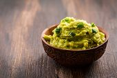 Guacamole on wooden table  poster