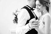 Beautiful wedding couple dancing indoor poster