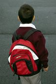 image of bagpack  - A Kindergarden kid going to school with his backpack - JPG