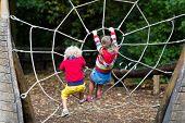 Children Climb On School Yard Playground poster