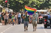 TEL-AVIV, ISRAEL - JUNE 12: Gay couple with rainbow colored flag during Annual Gay Pride Parade June
