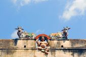 stock photo of meenakshi  - God and two cows on wall of Sri Meenakshi hindu temple in Madurai - JPG