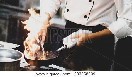 Chef Cooking With Flame In