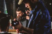 Barber With Hair Clipper Works On Hairstyle For Man With Beard, Barbershop Background. Haircut Conce poster