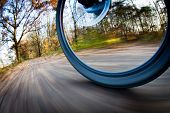 stock photo of pedal  - Bicycle riding in a city park on a lovely autumn - JPG
