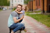 Young Happy Father Embracing Cute Little Daughter.love And Tenderness.. Quality Family Time. poster