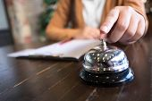 Women Call Hotel Reception With Finger Push A Bell In Lobby Hotel. Hotel Concept. poster