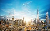 Dubai sunset panoramic view of downtown. Dubai is super modern city of UAE, cosmopolitan megalopolis poster